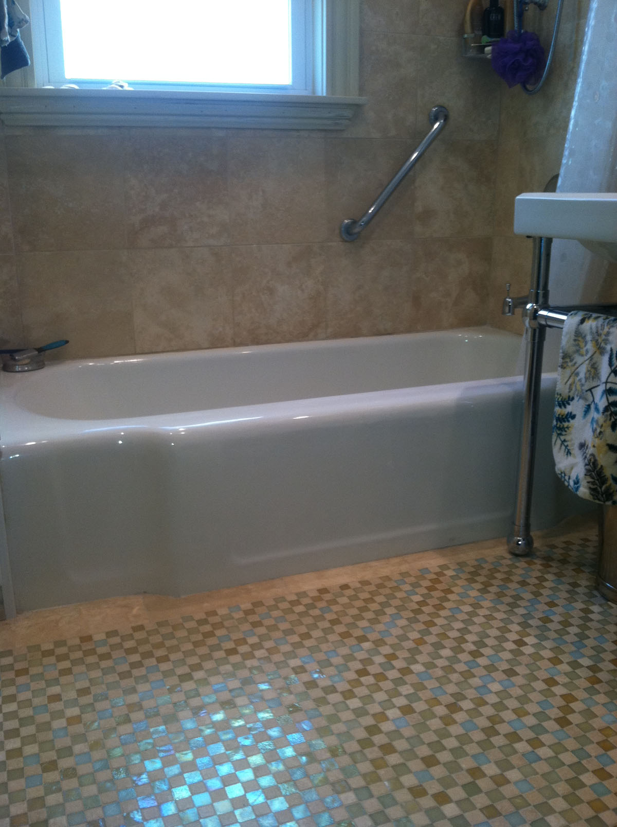 First Bathroom at Benton Rd. Somerville After Bathroom Remodel with New bathtub, floor tile, wall tile, accessible grab bar, and sink