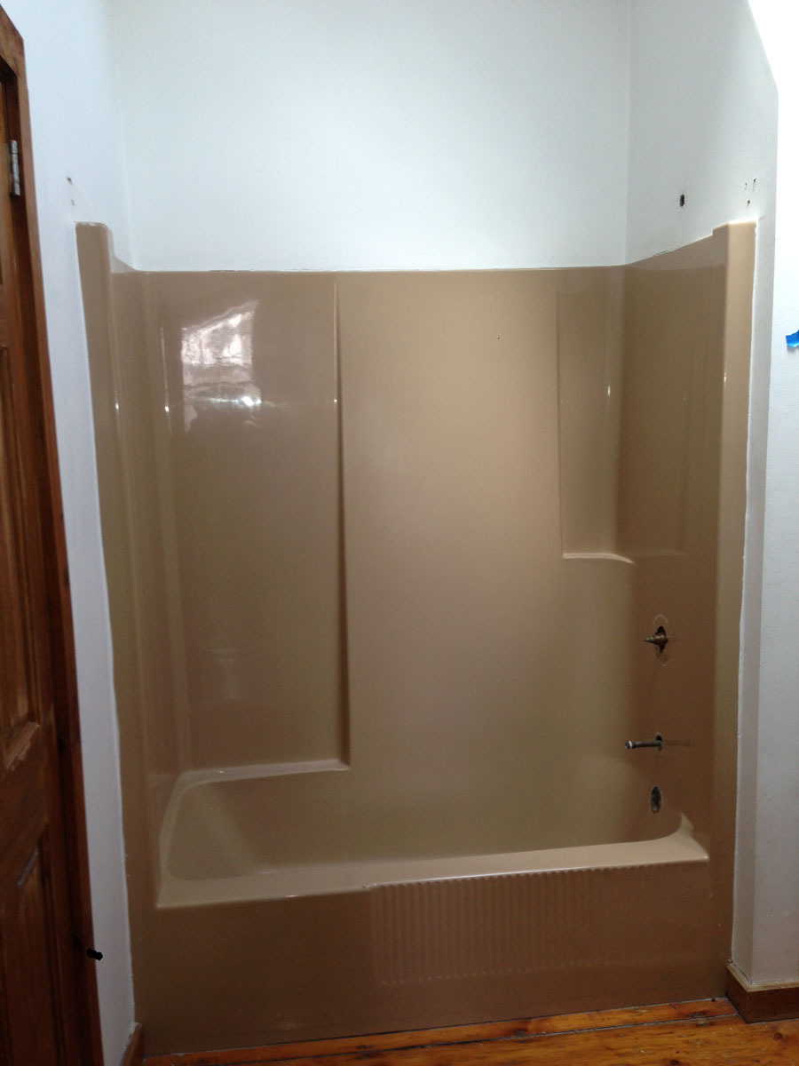 Combo fiberglass tub and shower unit prior to refinishing