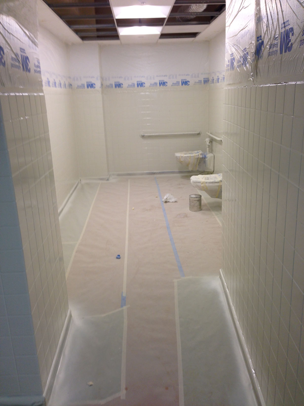 60 State St. Boston - Hotel public bathroom after refinishing