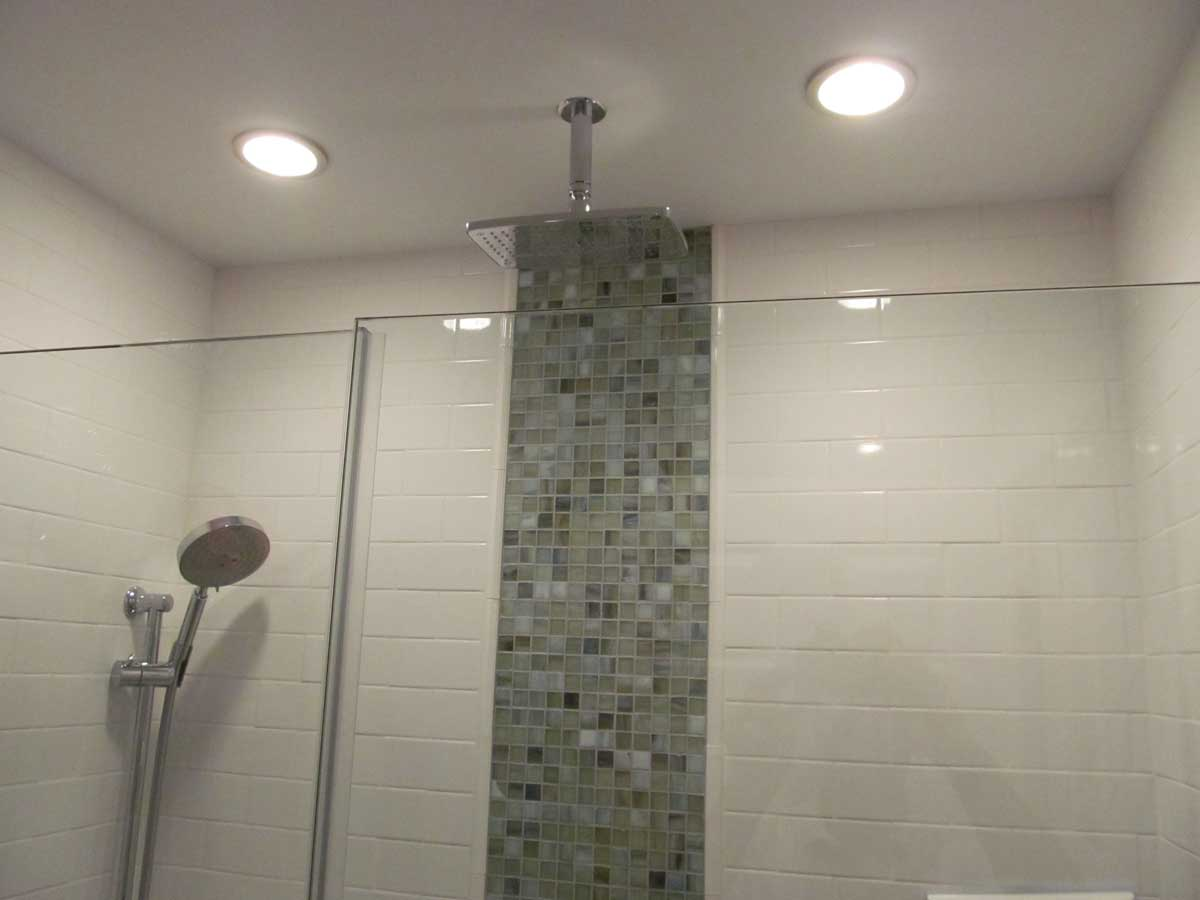 Multiple Shower Head Fixtures including Top Mounted Shower Fixture After Bathroom Renovation at Appleton St. Boston