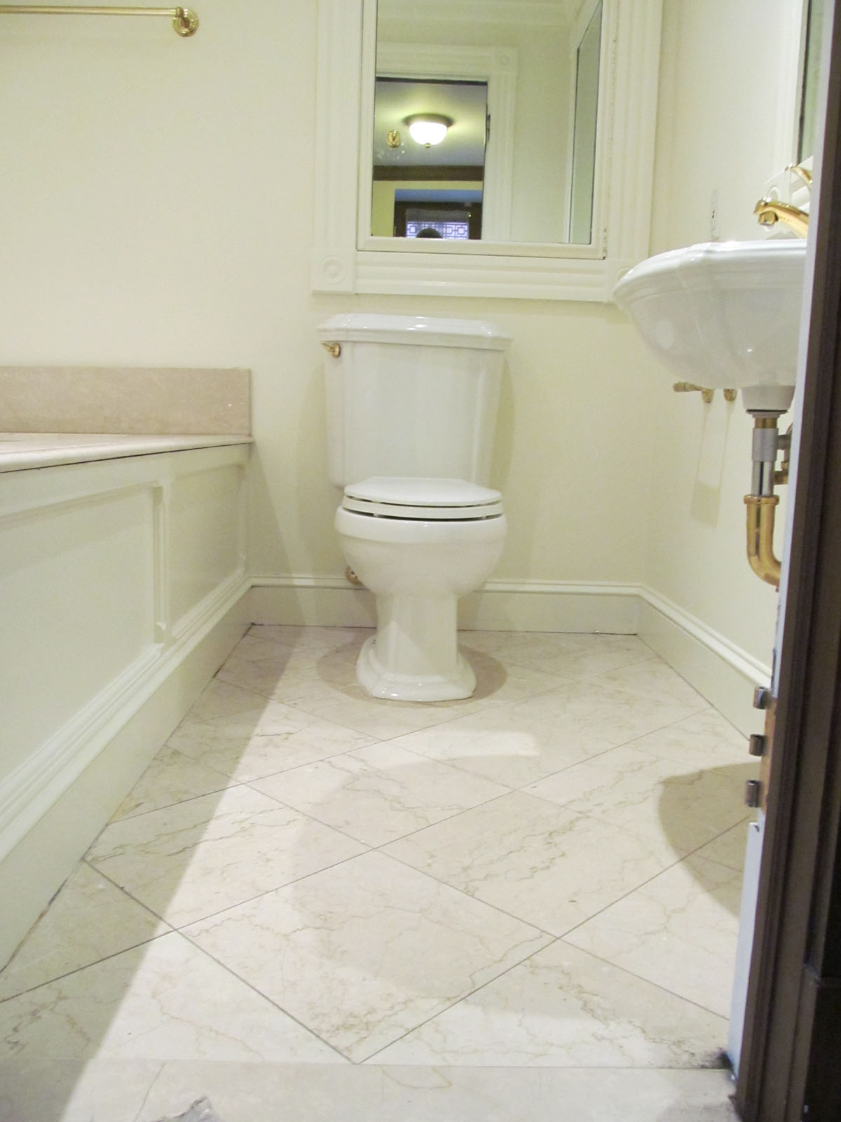Beacon St. Boston before remodel showing tub surround, sink, tile