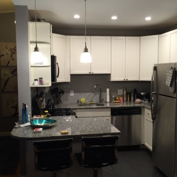 Refinished Eat-in Kitchen showing Marble Countertops & TableTabletop