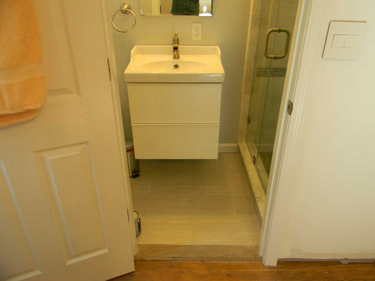 North St Newton - wall hung sink next to shower in expanded half bath