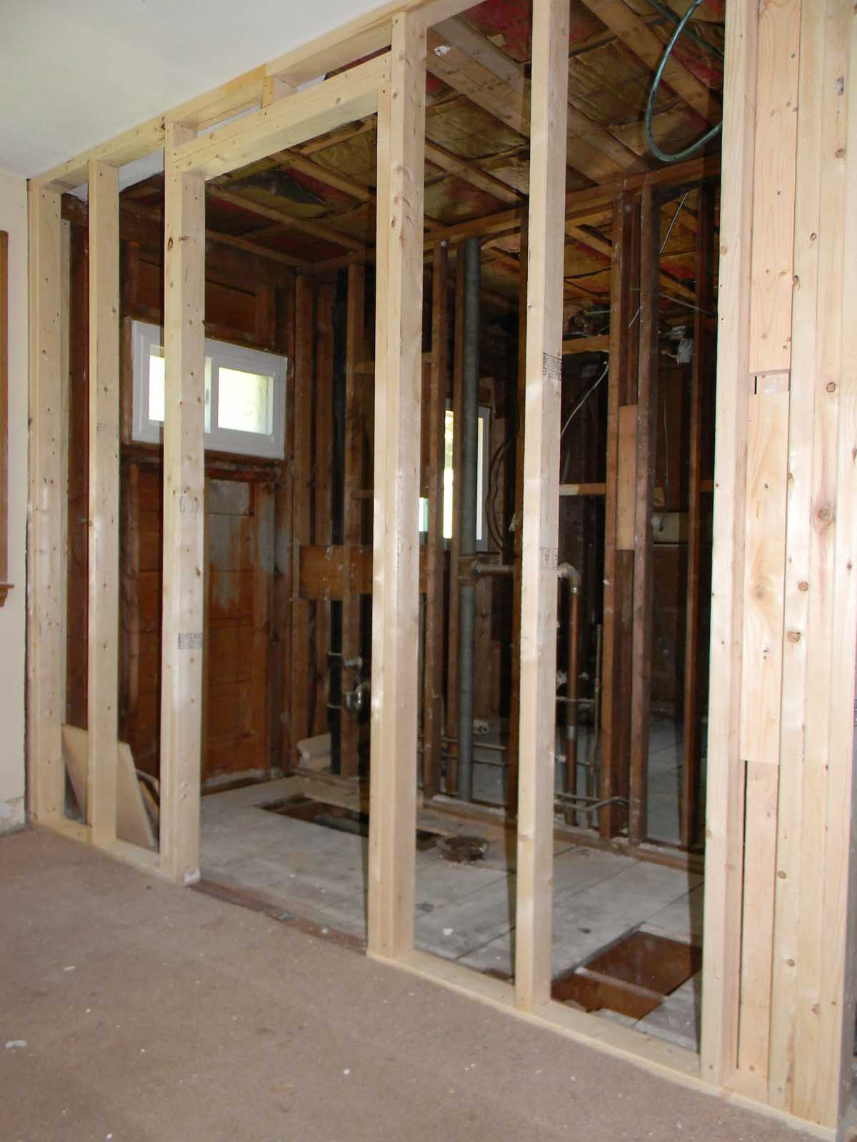 North St. Newton - bathroom renovation - studs out demo to enlarge half bathroom and add shower