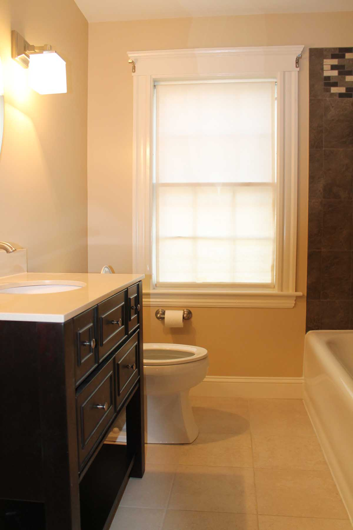 Wayne Rd. Needham - sink, toilet and floor tile details after bathroom renovation