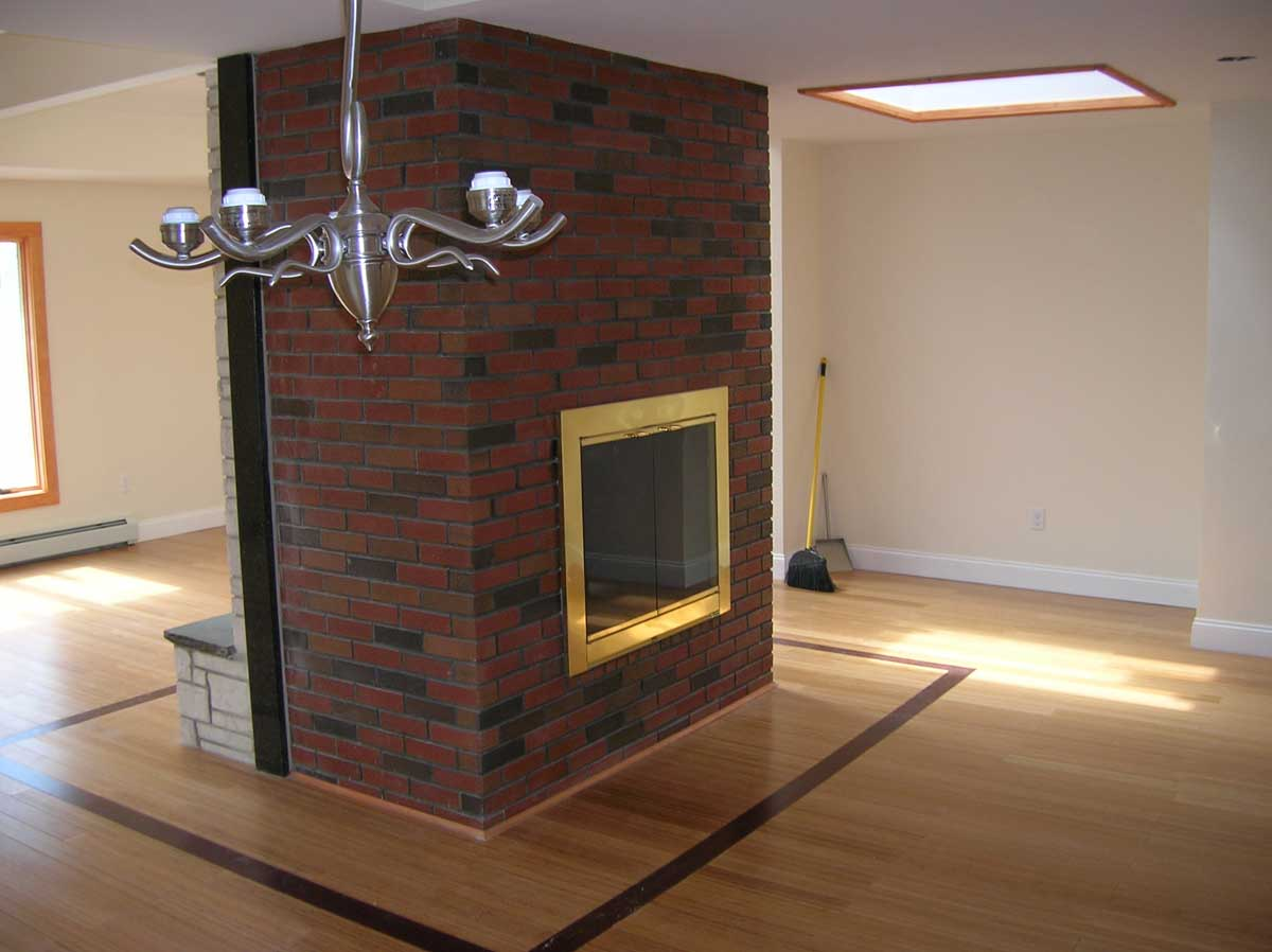 Skylight, fireplace and wooden floor detail after Brookline kitchen remodel