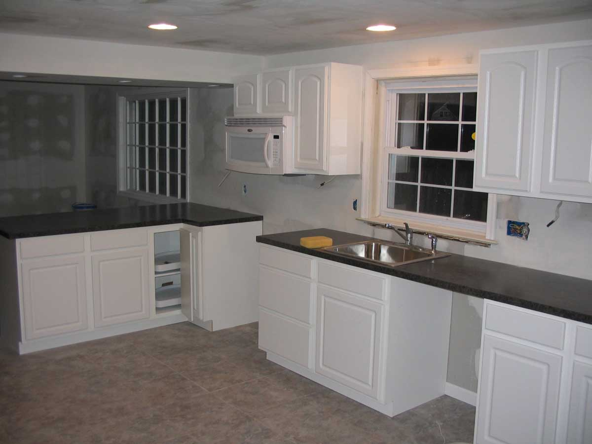 Partial kitchen renovation showing cabinets, sinks and windows - Walthm kitchen remodel