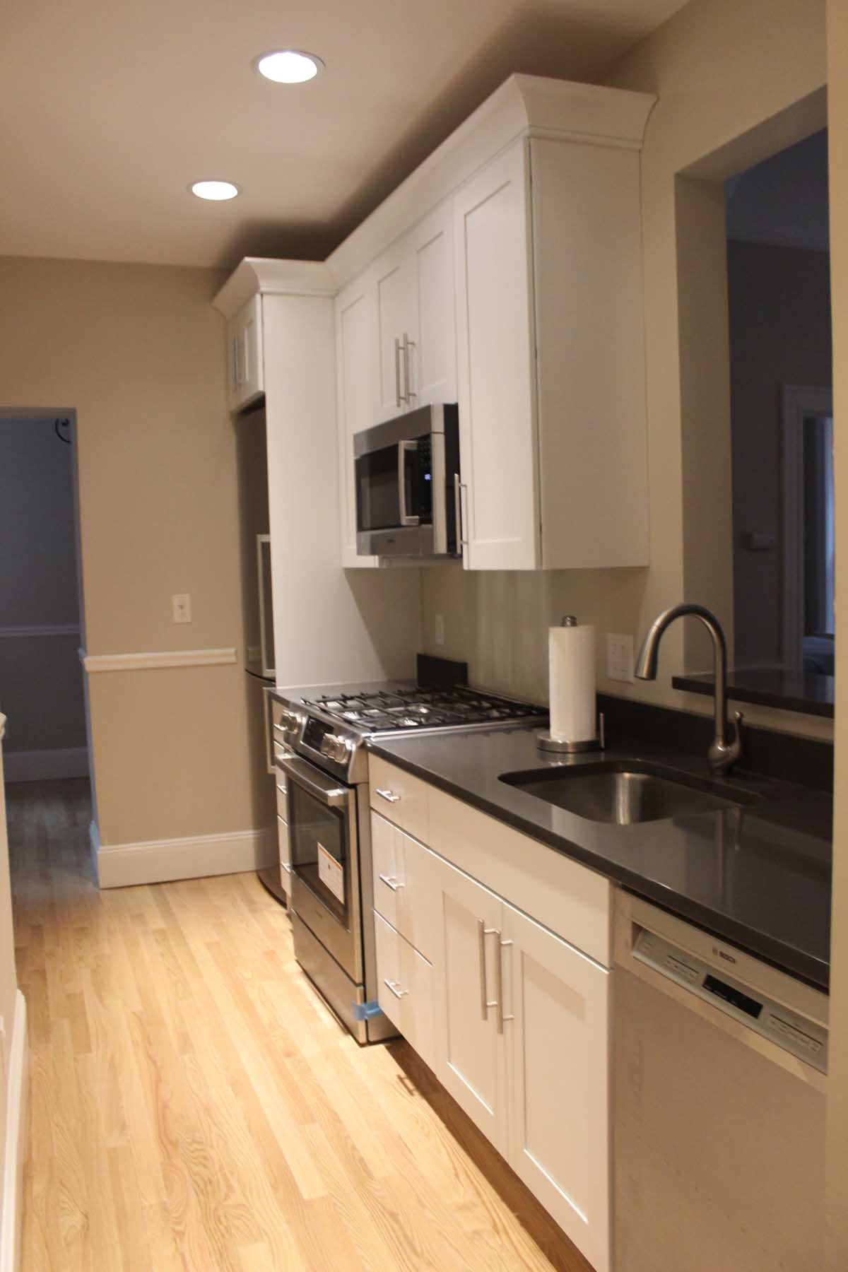 After Arlington kitchen remodel - wood floor, cabinets, countertop, lighting