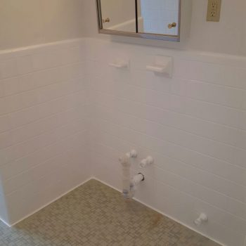 After bathroom wall tile reglazing - now a neutral but clean white