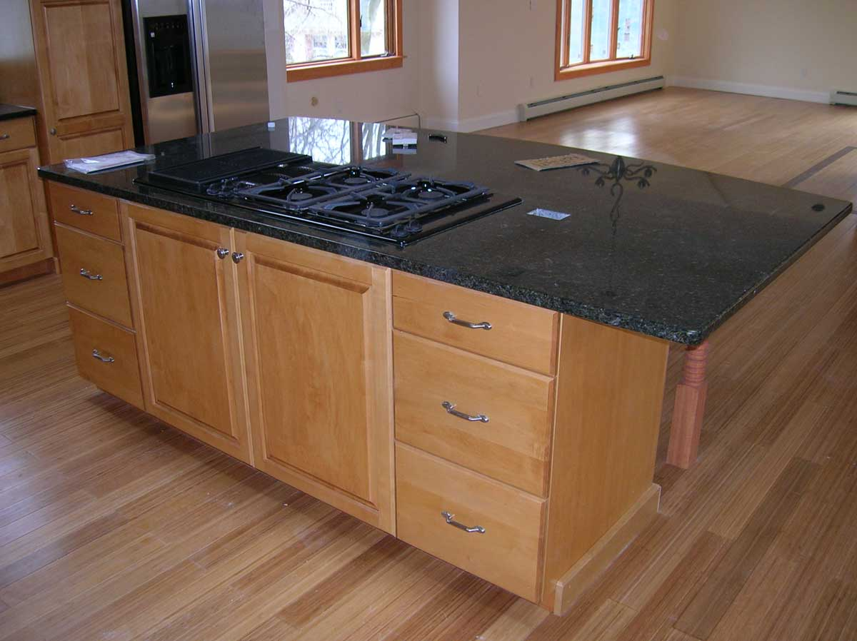Remodeled kitchen with Beautiful kitchen island and granite countertop - Brookline