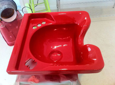 Classic bathroom sink refinished in a vivid red color