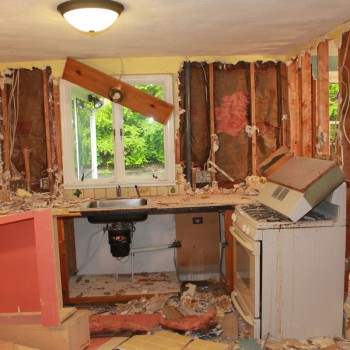 Newton kitchen during demolition - note low ceiling height and confined space