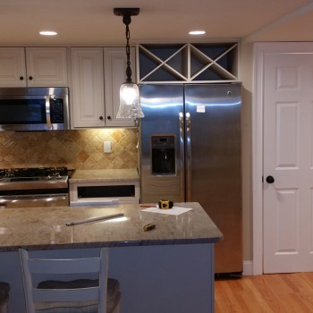 Improved lighting over kitchen island after Cambridge remodel