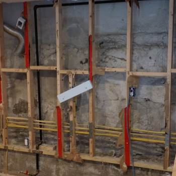 2nd St Cambridge - studs out wall replacement to repair basement kitchen water damage