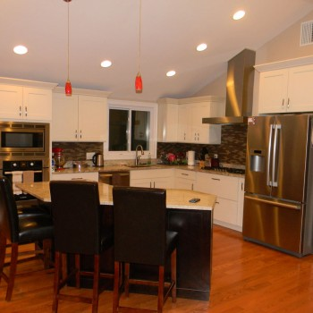 Newton kitchen remodel - showing new open, airy kitchen with cathedral ceiling and kitchen island dining area
