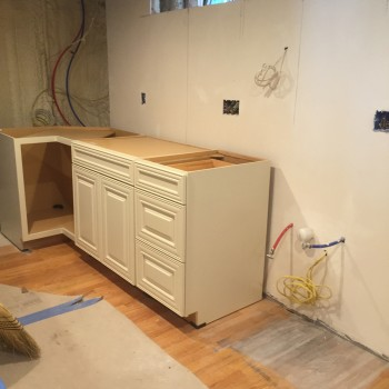 New sink and dishwaher area cabinetry and plumbing