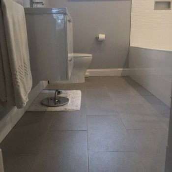 Gray Floor Tile and White Fixtures and Tile -Wellesley Bathroom Remodel